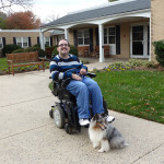 Disabled member in a wheelchair with his Shetland Sheepdog.