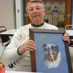 Member artist Lyn Skilman with her painting of a Shetland Sheepdog.